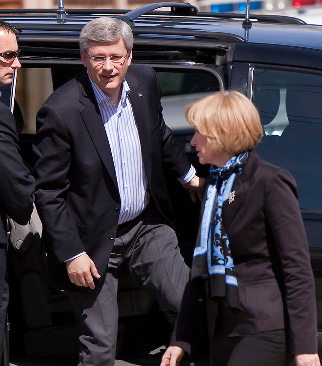 Conservative leader Prime Minister Stephen Harper and his wife Laureen arrive at St. Augustine Catholic school in Calgary, Alberta to cast their ballots in Canada's federal election May 2, 2011.<br /> AFP/GEOFF ROBINS/STR