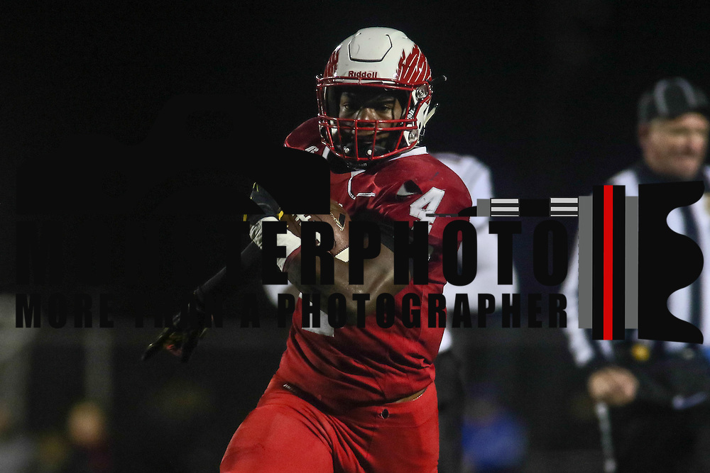 Smyrna running back Leddie Brown (4) breaks a tackle during a DIAA semi finals football game between No. 2 Smyrna and No. 3 William Penn Saturday, Nov. 26, 2016 at Charles V. Williams Stadium in Smyrna. Photo By Saquan Stimpson