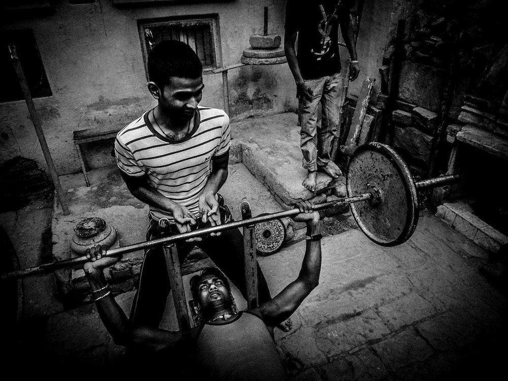 : India,Varanasi young body builder train hard dreaming a Bollywood work.