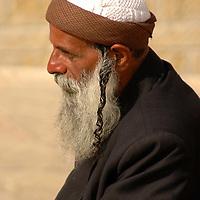 religious jew sitting near the Westren wall in Jerusalem