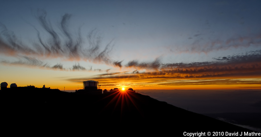 Sunset over Haleakala Satellite Tracking Station from Pu'U'Ula'Ula peak in Haleakala National Park, Maui Hawaii. Image taken with a Nikon D3x and 24 mm f/3.5 PC-E lens (ISO 100, f/16, 1/10 sec). Single shot HDR with Dx0 Pro
