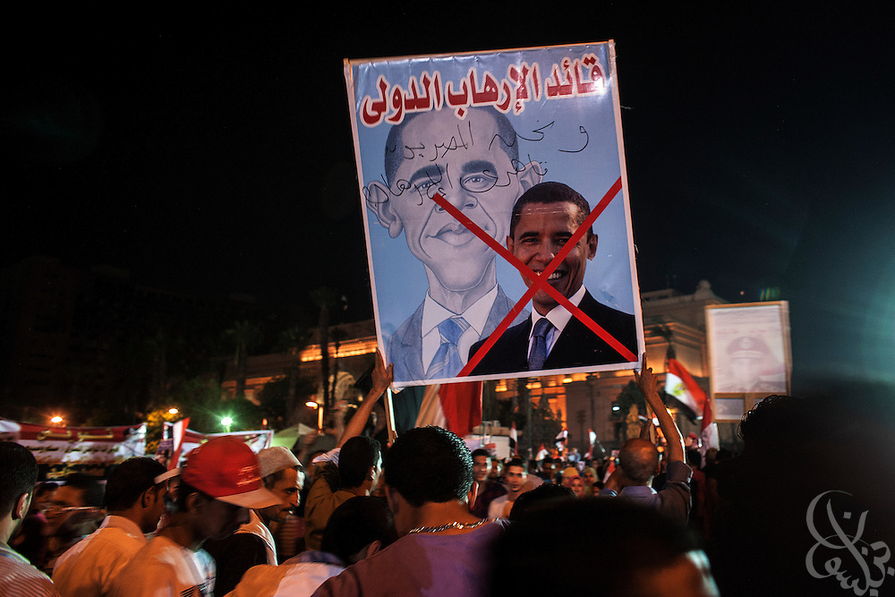 "Egyptians holding an anti-Barack Obama poster take part in mass demonstrations called for by Gen. Abdel Fattah El Sissi, the head of Egypt's military, in the Tahrir Square area of downtown Cairo Egypt on Friday July 26, 2013. EL Sissi had asked Egyptians to take to the streets on Friday to show the world that he had a mandate to deal with ""violence and terrorism""."