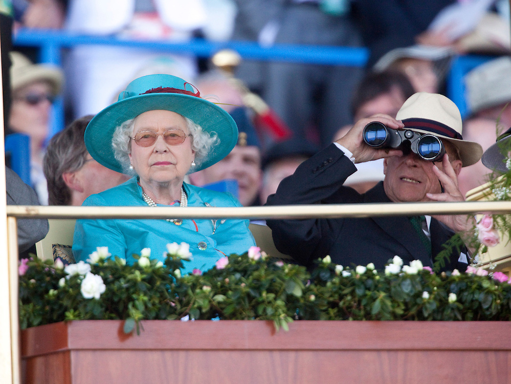 Queen Elizabeth II and Prince Philip, The Duke of Edinburgh watch the 151st running of the Queen's Plate at Woodbine racetrack in Toronto, Canada, July 4, 2010. <br /> AFP/GEOFF ROBINS/STR