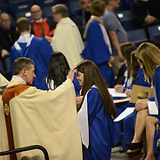 Bishop Cupich blesses a graduating student at the Baccalaureate Mass.