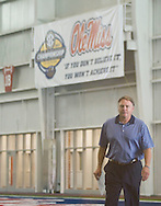 Mississippi football coach Houston Nutt walks to a press conference to answer questions about incoming players in Oxford, Miss. on Thursday, August 4, 2011.