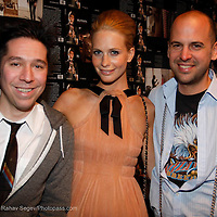 """Brian Wolk, Poppy Delavigne and Claude Morais attend the opening of """"Lady"""" by Douglas Friedman at the Ruffian Gallery on April 23, 2009 in New York City."""
