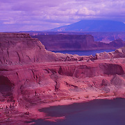 Gunsight Butte dominates this view of Lake Powell..Navajo Mountain is in the background.