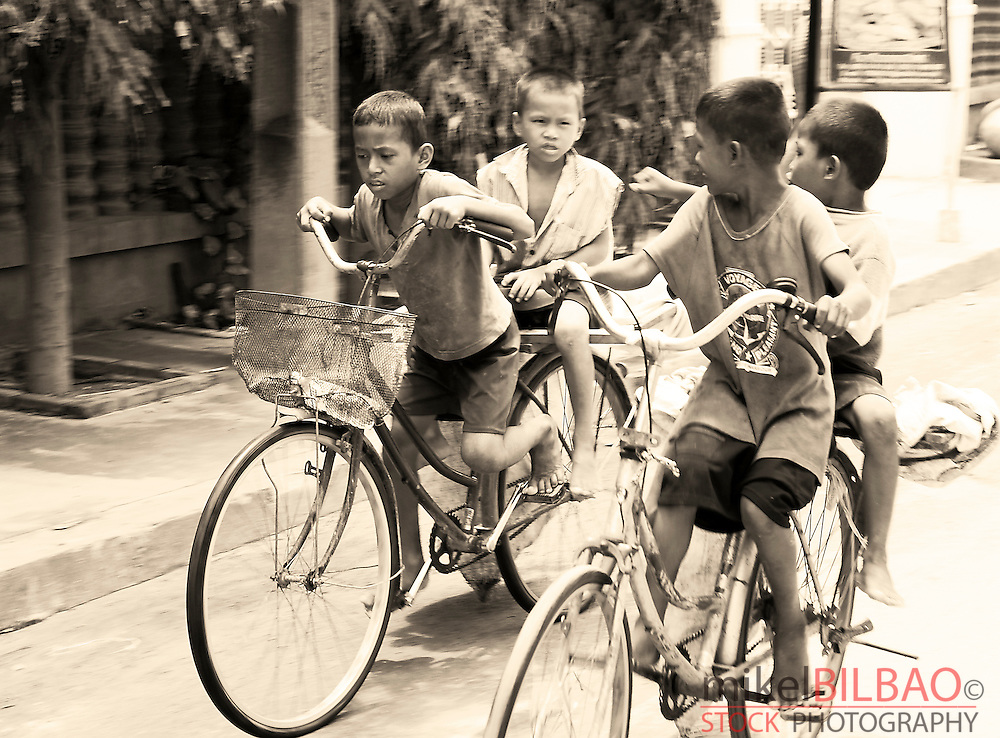 boys riding on bicycles.<br />