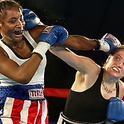 Boxing at the Chinook Winds Casino featuring a Commotion At The Ocean fight card with Portlander Molly McConnell (right) and her opponent Tracy Carlton (left) trading punches.....