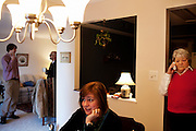 Linda Groeber, 67, talks on the phone while her family hangs out around her house during a family visit in Lutherville-Timonium, Maryland on Wednesday, January 13, 2010. As she ages Linda has relied more on her daughters Tracey Brown and Annie Groeber to help with day-to-day tasks.