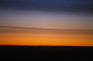 Venus in Dawn Sky, March 31, 2001, one day after inferior conjunction. Venus had passed 8&deg; north of Sun, a wide separation at inferior conjunction, making it possible to see Venus right at inferior conjunction in the daytime near the Sun, and as here, rising just before the Sun at dawn. <br /> <br /> Phase of Venus is just barely visible (Venus disk = 60 arcseconds across)<br /> <br /> Taken with 200mm telephoto lens at f/4 with Fujichrome Provia 100F slide film. Taken thru kitchen window!