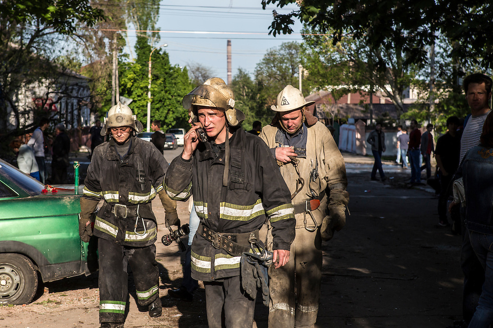 MARIUPOL, UKRAINE - MAY 10: Firefighters remain at the scene of a still-smoldering burned police statio a day after deadly clashes on May 10, 2014 in Mariupol, Ukraine. A referendum on greater autonomy is planned for the region tomorrow. (Photo by Brendan Hoffman/Getty Images) *** Local Caption ***