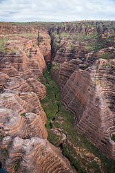 A small waterway snakes through the Bungle Bungles (Purnululu) in the east Kimberley region of Western Australia.