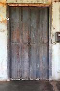 Weathered door in San Antonio de Rio Blanco, Mayabeque, Cuba.
