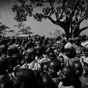 Cameroon/CAR refugees/ Young CAR refugees watch with circumspection the show of clowns without borders performed on december 4, 2014, at the Gado refugee site. /UNHCR/O.Laban-Mattei/December 2014