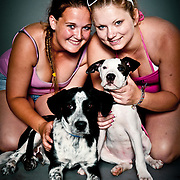 Lizzy Rutherford with Bentley, a border collie mix, and Nina Berryman with Triton, a 12-week-old pit bull.