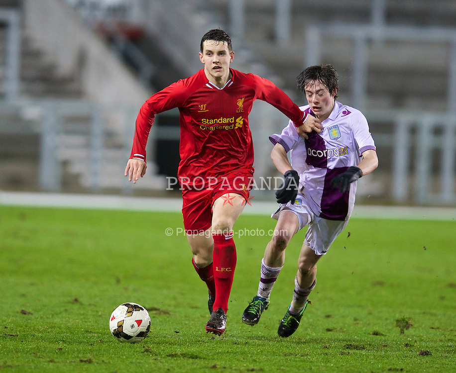 ST. HELENS, ENGLAND - Wednesday, January 15, 2014: Liverpool's Jordan Williams in action against Aston Villa's Harry McKirdy during the FA Youth Cup 4th Round match at Langtree Park. (Pic by David Rawcliffe/Propaganda)
