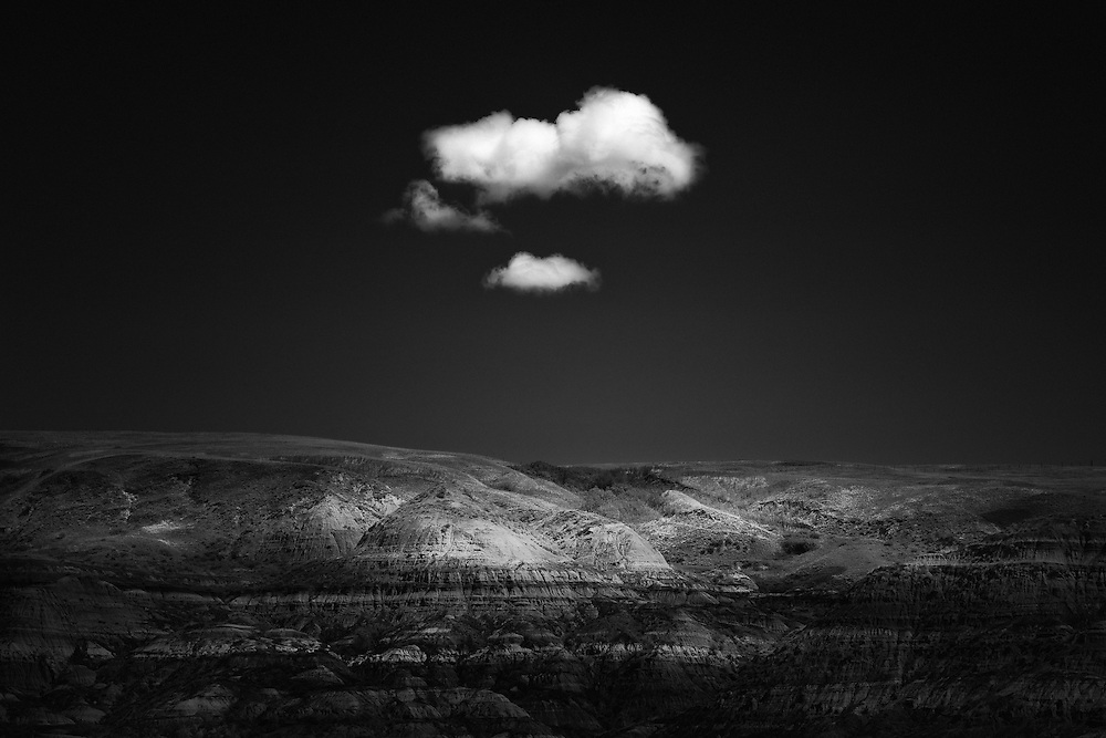 A lone cloud floats over the Bad Lands in Drumheller