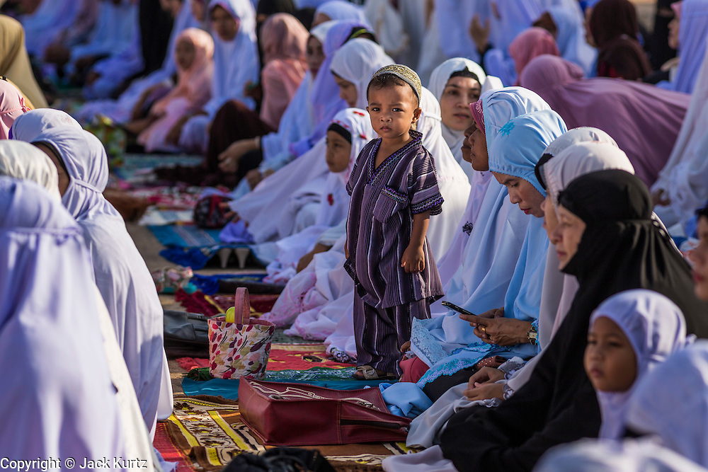 Women and children during Eid services at Songkhla Central Mosque in Songkhla province of Thailand. Eid al-Fitr is also called Feast of Breaking the Fast, the Sugar Feast, Bayram (Bajram), the Sweet Festival and the Lesser Eid, is an important Muslim holiday that marks the end of Ramadan, the Islamic holy month of fasting.