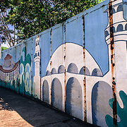 Brazilian side of The Friendship bridge over Rio Paranà that divides Brazil and Paraguay and the town of Foz do Iguacu and Ciudad del Este. Murales of the Catholic church, the Buddist temple and the mosque of Foz do Iguacu