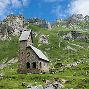 """At Meglisalp is a 1904 mountain chapel (Kapelle Maria zum Schnee, """"Holy Mother Mary of the Snow""""). Berggasthaus Meglisalp can only be reached on foot in the heart of the Alpstein mountain chain in the Appenzell Alps, Switzerland, Europe. This authentic mountain hostelry, owned by the same family for five generations, dates from 1897. Meglisalp is a working family dairy farm."""