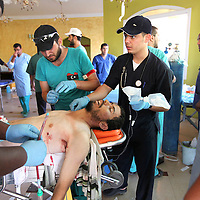Volunteer medics at a field hospital clean the body of 21-year-old Abdel Aziz Al-Bawel, an anti-Gaddafi fighter, who was killed by a sniper's bullet on the front line in Sirte, Libya. September 2011.