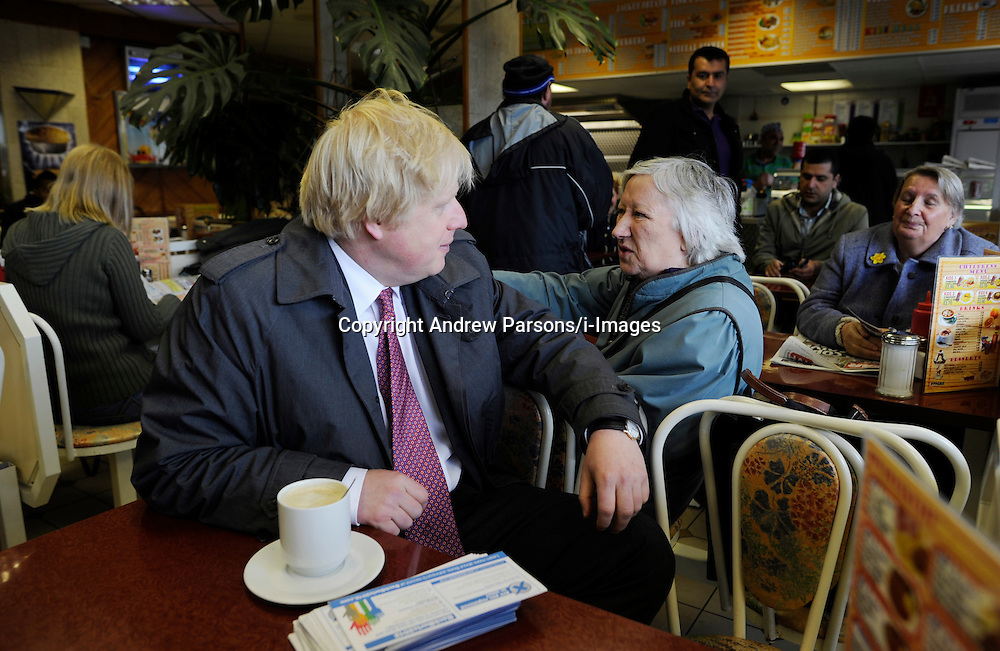 The London Mayor Boris Johnson chats to a lady while having a cup of tea in a cafe during his campaigning  in Penge, South London, during his Mayor Campaign, Wednesday April 25, 2012 Photo By Andrew Parsons /i-Images