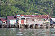 Row of wooden stilt houses in the Water Village, Kampung Buli Sim Sim, Sandakan, Sabah