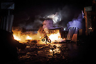 Violent clashes opposed protesters and riot police on Hrushevskoho street with barricades and police trucks set on fire in Kiev, 22 January 2014.