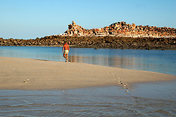 A lone visitor walks along a remote beach in Camden Sound on the Kimberley coast.  Camden Sound has been announced as the Kimberley's first marine park.
