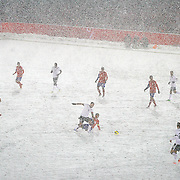 SHOT 3/22/13 9:38:16 PM - United States forawrd Clint Dempsey #8  chases after a loose ball in heavy snow against Costa Rica during their World Cup qualifying game at Dick's Sporting Goods Park in Commerce City, Co. on Friday March 22, 2013. The U.S. won the game 1-0 in a spring blizzard that blanketed the pitch and stadium in snow. (Photo by Marc Piscotty / © 2013).