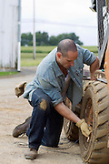 man repairing a tractor tire