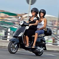 Chioggia, Venetian Lagoon, Italy 29 June 2009<br /> Italians riding a Vespa.<br /> PHOTO: EZEQUIEL SCAGNETTI