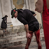 A Battente flagellates himself in front of the main church of the village of Nocera Terinese