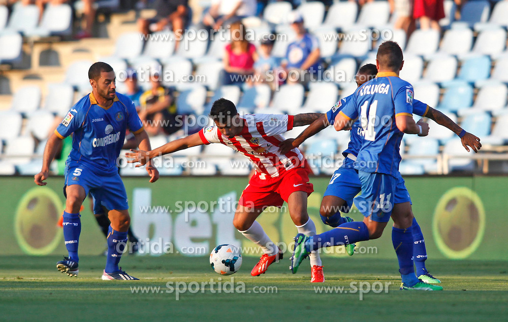 23.08.2013, Coliseum Alfonso Perez, Getafe, ESP, Primera Division, FC Getafe vs UD Almeria, 2. Runde, im Bild Getafe's Mehdi Lacen (l) and Almeria's Angel Trujillo (c) // during La Liga match.August 23,2013, during the Spanish Primera Division 2nd round match between Getafe CF and UD Almeria at the Coliseum Alfonso Perez, Getafe, Spain on 2013/08/23. EXPA Pictures &copy; 2013, PhotoCredit: EXPA/ Alterphotos/ Ricky Blanco<br /> <br /> ***** ATTENTION - OUT OF ESP and SUI *****
