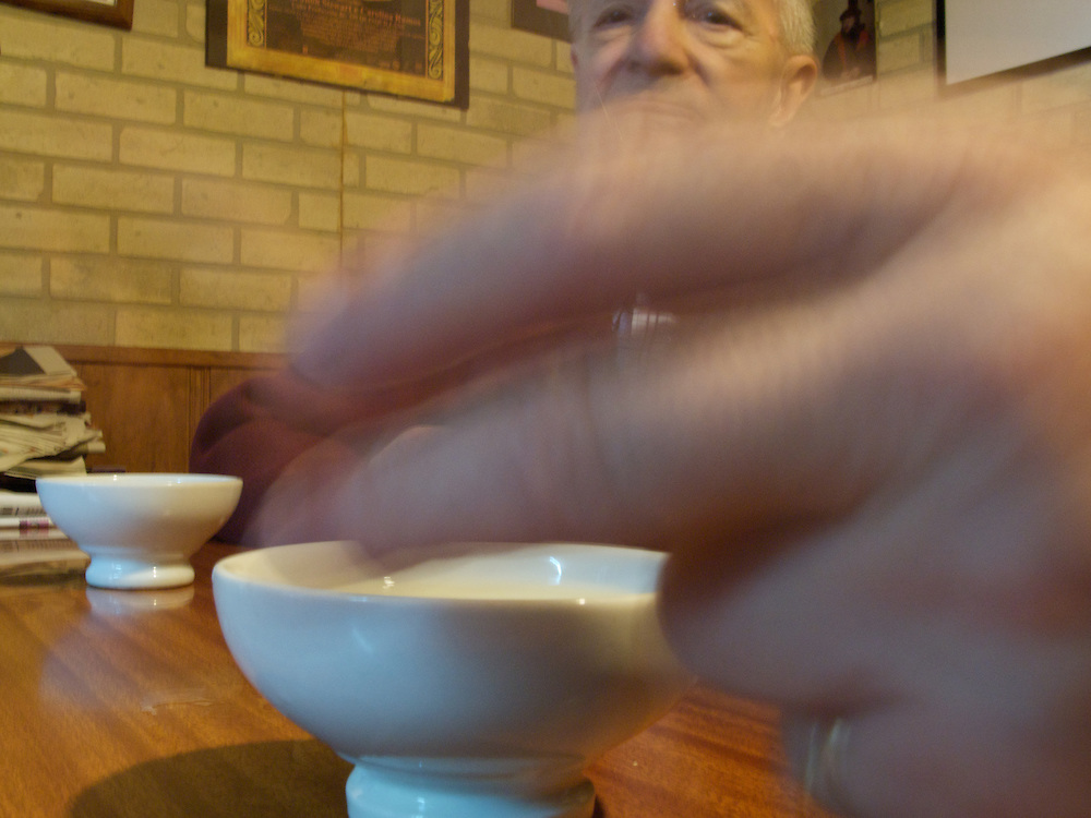 In Santiago de Compostela, some locals drink a bowl of local wine. The wine is served in small crucibles decanted from large wooden barrels.