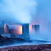 Iceland, Grindavik, Steam  billows from Reykjanes Geothermal Plant on spring evening
