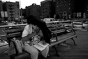"""Antonina -who seemingly unbothered by the biting ocean wind- explained """"in Russia I was an educated woman, but now I speak like a kindergarten child."""" In the 1980s a new dialogue was heard on the streets, a new wave of Russian immigrants washed ashore in Brighton Beach. It was a cultural shock for them and for the older Americans who remained. Language for many was a barrier frustrating many of the new arrivals."""