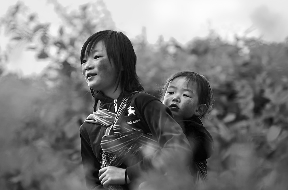 A girl caring for her sister in eastern Bhutan.