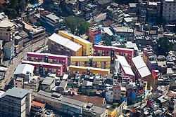 Moradias coloridas construidas pelo PAC, em projeto de revitalizacao da Rua 4,na favela da Rocinha, uma das maiores favelas da cidade do Rio de Janeiro./ Colorful houses built by the PAC in revitalization project of 4th Street, in the slum of Rocinha, one of the biggest slum in the city of Rio de Janeiro. RJ, Brasil - 2011