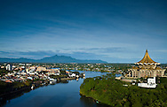 a view of the Sarawak river, Kuching city on the left, the gold structure on the right is the state assembly building, the white building in the right foreground is Fort Margherita