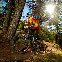 A rider goes out for her last lap of the weekend on Sunday during the 24 Hours in the Enchanted Forest near Gallup, N.M.