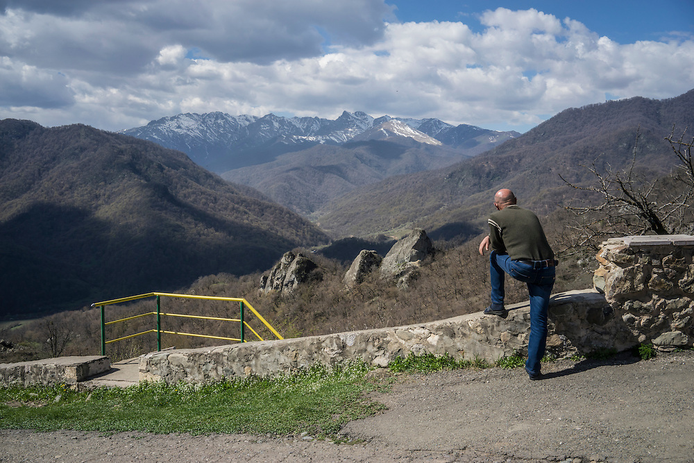 MARTAKERT, NAGORNO-KARABAKH - APRIL 18: A man gazes out at mountains visible from Gandzasar Monastery on April 18, 2015 in Martakert, Nagorno-Karabakh. Since signing a ceasefire in a war with Azerbaijan in 1994, Nagorno-Karabakh, officially part of Azerbaijan, has functioned as a self-declared independent republic and de facto part of Armenia, with hostilities along the line of contact between Nagorno-Karabakh and Azerbaijan occasionally flaring up and causing casualties. (Photo by Brendan Hoffman/Getty Images) *** Local Caption ***