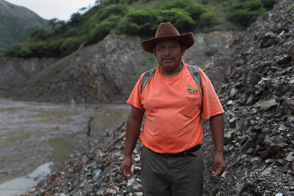 Massacre survivor Cupertino Sanchez walks near the Chixoy reservoir's current water line a few meters below the new Rio Negro community. Nearly 400 community members of Rio Negro were killed in four separate massacres in 1981 and 1982 due to the community's resistance to give up their lands and make way for the Chixoy hydroelectric project. Rio Negro, Rabinal, Baja Verapaz, Guatemala. May 29, 2012.