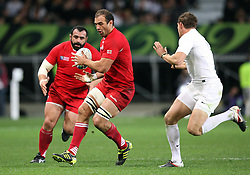 Georgia's Mamuka Gorgodze, centre, looks to offload the ball in the Rugby World Cup pool match at Otago Stadium, Dunedin, New Zealand, Sunday, September 18, 2011. Credit:SNPA / Dianne Manson.