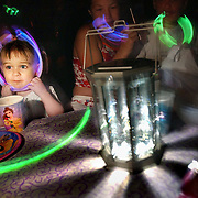 After the sun went down and twilight passed, Aimee Milota's second birthday party began outside in the dark at her neighborhood swim club. Aimee has xeroderma pigmentosum, a rare genetic disease that causes her skin to be ultrasensitive to the sun. July 2, 2004