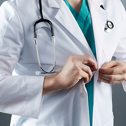 A portrait series representing the intense emotions that Doctors face.  A white male Doctor wearing a white lab coat, stethoscope, and green medical scrub suit shown.