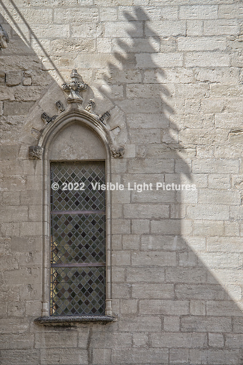 One of the stained glass windows at the Popes's Palace and a shadow from a nearby tower, captured by Susan.