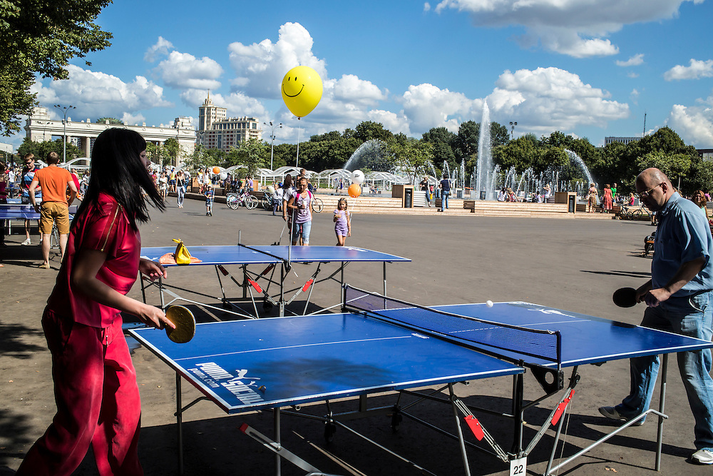Aleksandra Borshcheva and her husband Andrei Borshchev play ping-pong in Gorky Park on Saturday, August 17, 2013 in Moscow, Russia.