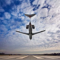 A plane lands on runway 11 at St. Louis-Lambert International Airport in St. Louis, Mo., Friday, Dec. 29, 2006.